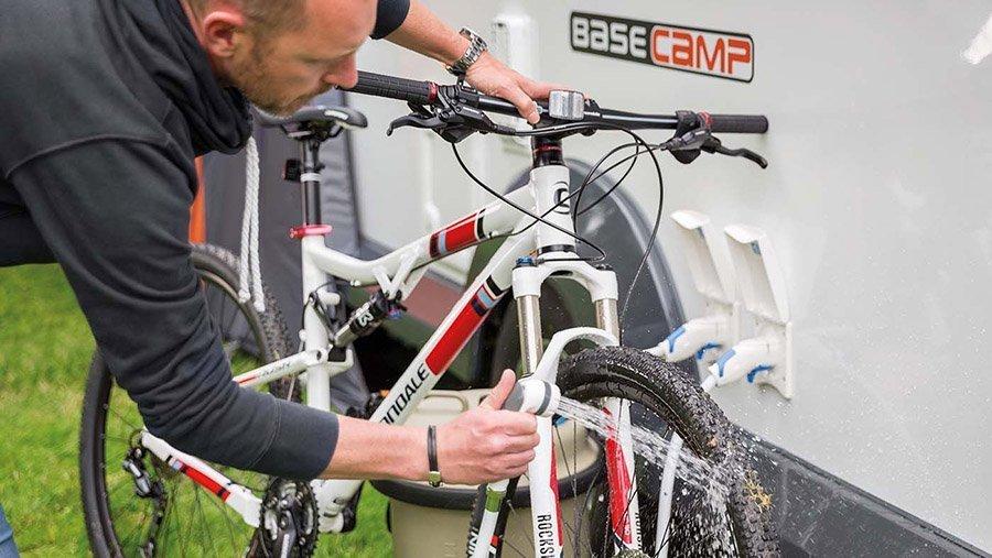 Staycation uk man washing his bike